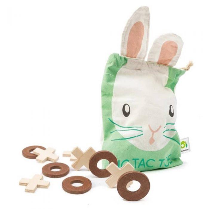 Jeu de morpion en bois accompagné de son sac de rangement qui permet de jouer dessus de la marque Tender Leaf Toys